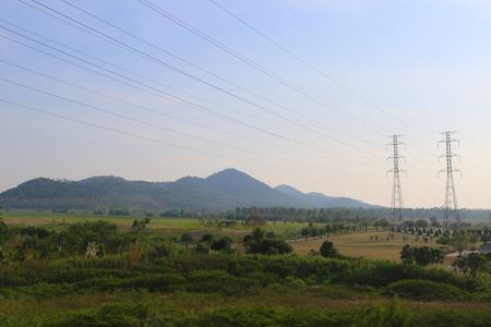 high voltage current: Natural scenery and high voltage poles in rural areas of the Thailand.