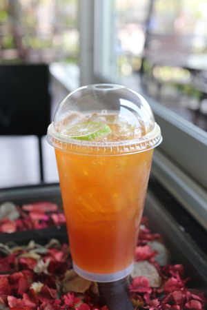 reduces: Cold lemon tea for reduces thirst water in the cafe.