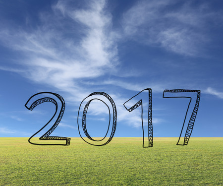 anno: Hand drawn numbers show 2017 year on natural background. Stock Photo