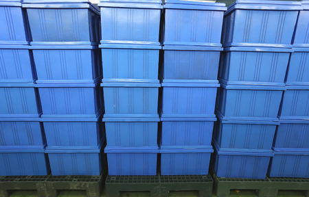 finished good: blue Plastic box products in Industrial factory room,Container of finished goods germ-free.