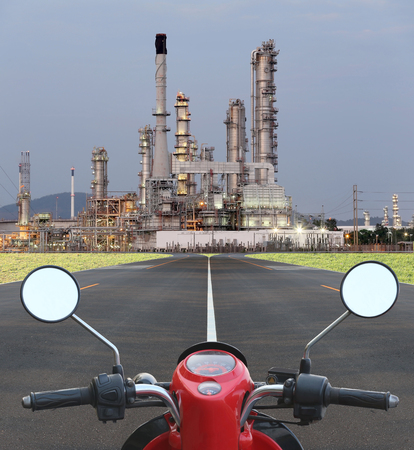way to go: Motorcycle on the way go to oil refinery,Concept for add fuel and power search.