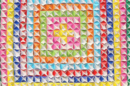decorate: Artificial colorful paper a triangle and a square for design and decorate the background. Stock Photo