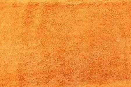 microfiber cloth: Orange color Texture of microfiber Cloth for the design background.