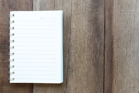 add text: Notebook on old wood for the design background,Blank paper to take notes or add text to it.