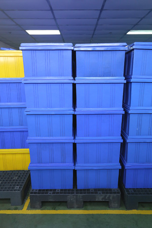 blue Plastic box products in Industrial factory room,Container of finished goods germ-free.