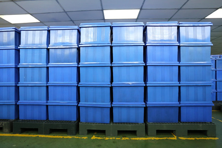 finished: blue Plastic box products in Industrial factory room,Container of finished goods germ-free.