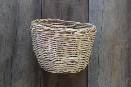 housewares: Basket weave of handicraft on old wooden for the design background.