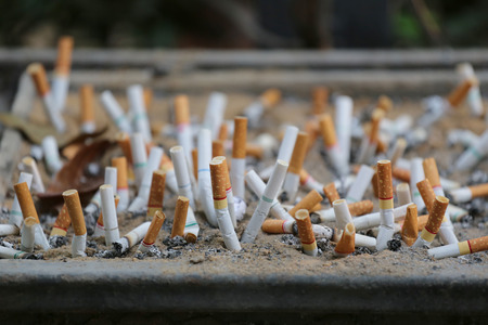 dumped: cigarette stub are dumped in the special utensil,device in the smoking area.