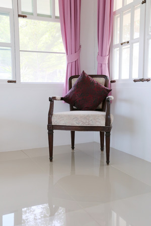 antique chair: Vintage antique chair in the living room with window and blinds pink.