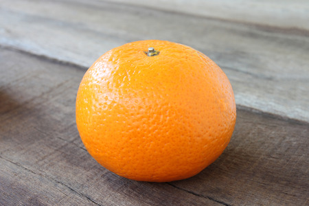 sweet pulp: fresh orange fruit placed on wooden floor in concept of healthy eating.