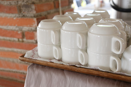 housewares: white cup of coffee drink to prepare for customer in a restaurant.