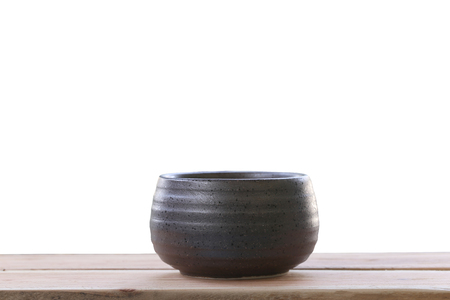 objects with clipping paths: old jar earthenware of japanese style (japanese sake bottle) on wood floor
