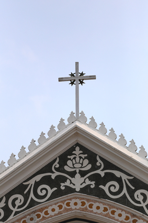 weather gauge: crucifix on roof architecture of the church on clear day,sanctuary in Thailand.