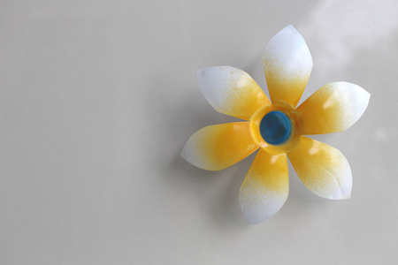 wall decor: Artificial flowers on wall in home decor,made from plastic water bottles.