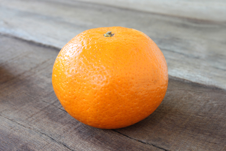 placed: fresh orange fruit placed on wooden floor in concept of healthy eating.