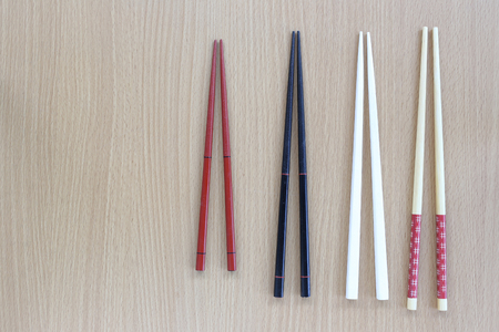 housewares: chopsticks in top view on wood background for design concept food.