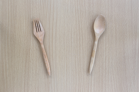 housewares: Wooden spoon and fork in top view on wood background for design concept food.