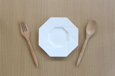 housewares: Wooden spoon,fork and dish in top view on wood background for design concept food.
