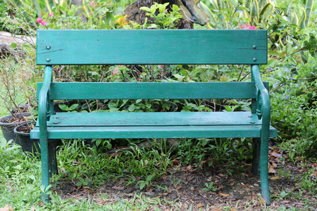 garden lawn: Green chair or bench on ground in public park and nobody,There is space available for use. Stock Photo