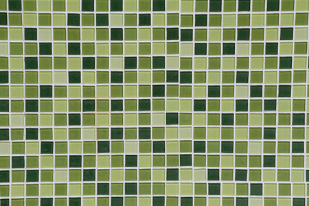 hues: Toilet Wall of made of different hues in green tiles for the design background.