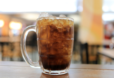 quenching: Glass of cola on a table in a restaurant,Soda beverage for quenching thirst.