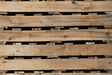by placing: old wood texture of pallets for background,Planks used to make placing the product for the industry.