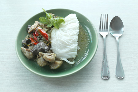luscious: Curry chicken noodles (KHANOM CHIN) with vegetable,This is local Thai foods in Vermicelli rice. Stock Photo