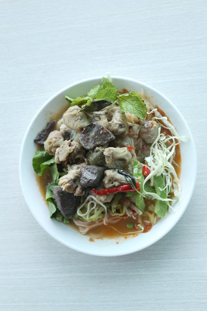 Curry chicken noodles (KHANOM CHIN) with vegetable,This is local Thai foods in Vermicelli rice. Stock Photo
