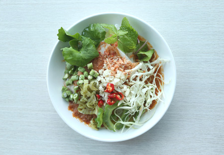 Local Thai foods of Rice Vermicelli is name KHANOM CHIN,spicy noodles with vegetable and hot soup. Stock Photo