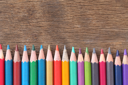 color pencils: Closeup Color pencils concatenation on old wooden background for concept design of education. Stock Photo