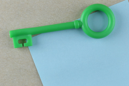 input: Green Plastic key is placed on Blue Paper Note and can input text to it.