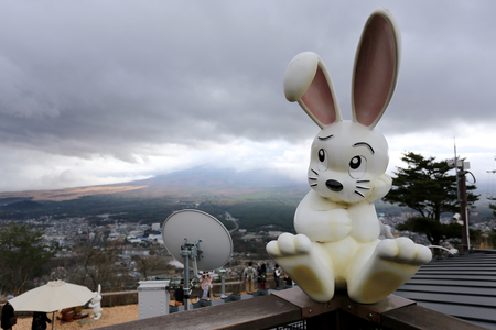 Rabbit statue on the tenjo mountain point of view to Mount Fuji in bad weather day Cloud heavy cover.