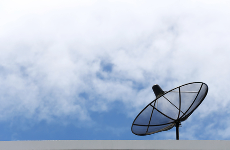 Satellite dish and Clouds on the Blue sky in concept of Communications. Stock Photo
