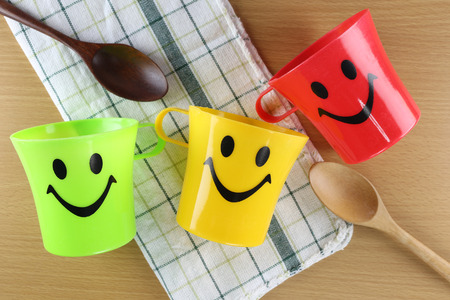 housewares: Colorful of Mug with smiley symbols in design Healthy concept. Stock Photo