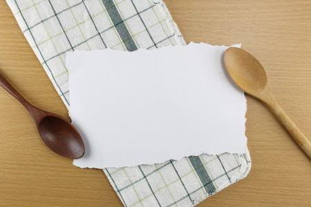 add text: Wooden spoon placed on white paper torn by hand can add text to it. Stock Photo