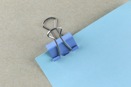 paper pin: PaperClip action pin in blue paper note on Brown cardboard and can input text to it. Stock Photo