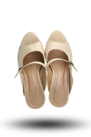 cream color: Cream color of fashion shoes isolated on white background and have clipping paths.