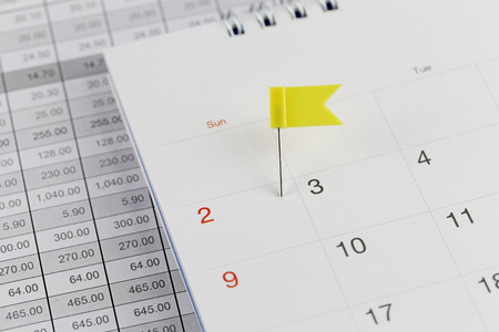 wildcats: Yellow Pins to Wildcats on the calendar beside the number of two in business concept time and date. Stock Photo