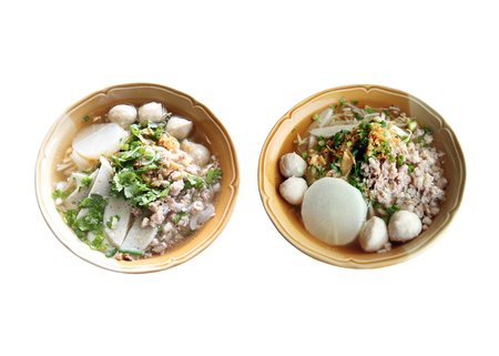 objects with clipping paths: Thai foods of noodles with boiled pork in brown bowl isolated on white background and have clipping paths.