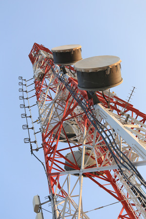 wireless tool: Antenna for Telephone communications in bright sky day time and have equipment connection tool of Wireless Internet business. Stock Photo