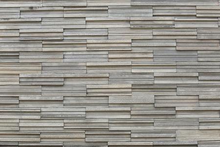 Vieja textura de la pared de piedra en degradado y tienen superficies naturales para el diseño de fondo.