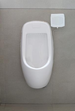 Modern urinal in men bathroom, white ceramic urinals for men in toilet room. Stock Photo