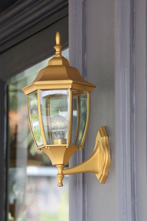 mounted: Golden lamp mounted on wall,Lantern of equipment outside decoration. Stock Photo