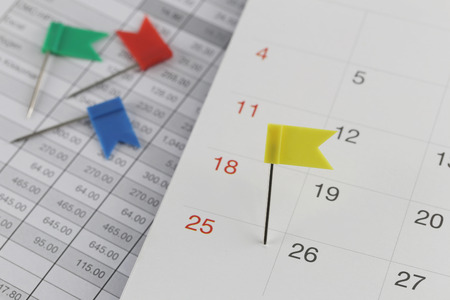 wildcats: Yellow Pins to Wildcats on the calendar beside the number of twenty five in business concept time and date.