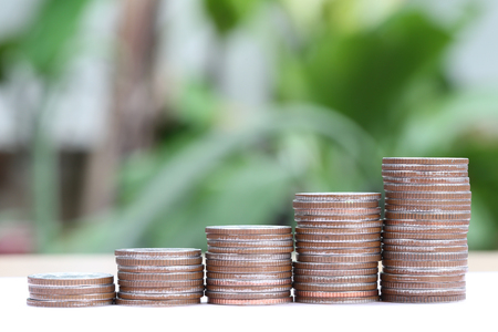 silver Thailand coins stack in business growth concept and green abstract background. Stock Photo