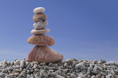 rock pile: Balance stone on pile rock with blue sky background for concept of Zen and calm.