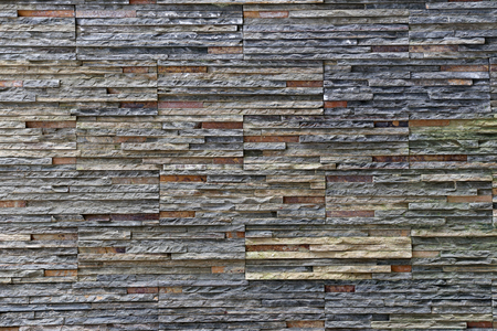 stone wall texture: old stone wall Texture in weathered and have natural surfaces for design background.