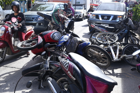 negligence: CHONBURI - June 13 :Motorcycle accident caused on street by the negligence of large truck,Industrial estates Saha Group in Sriracha,13 June 2016 Chonburi province at Thailand.
