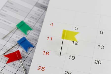 wildcats: Yellow Pins to Wildcats on the calendar beside the number of eighteen in business concept time and date.