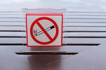 interdiction: Signs of no smoking on the table in restaurant.